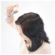 Spray Super Million Hair again to lock in hair fibers.